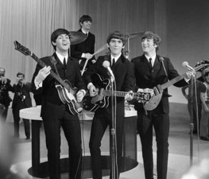 "Originally, The Beatles' work focused around themes of optimistic, giddy, love akin to that of a boy who had just fallen in love, as typified by their performances of songs on The Ed Sullivan Show, such as ""All My Loving"", """" and """"."