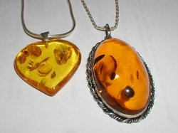Amber pendants. The oval pendant is 52 by 32 mm (2 by 1.3 inches).