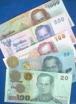 Thai banknotes and coins.