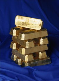 Gold ingots like these, from the , still form an important currency reserve and store of private wealth.