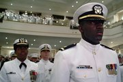 Newly graduated and commissioned officers of the Naval Reserve Officers Training Corps (NROTC) Unit Hampton Roads stand at attention as they are applauded during the Spring Commissioning Ceremony